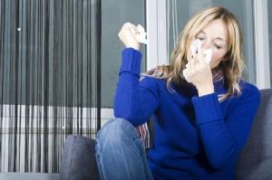 someone sneezing indoors